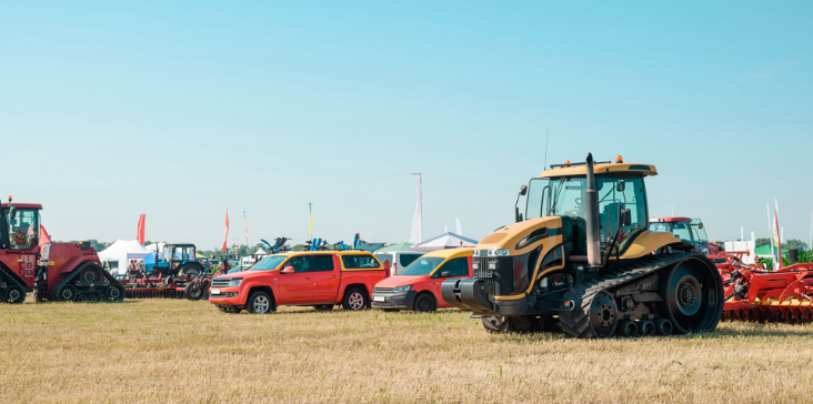 Vehicles on display outside at live auction